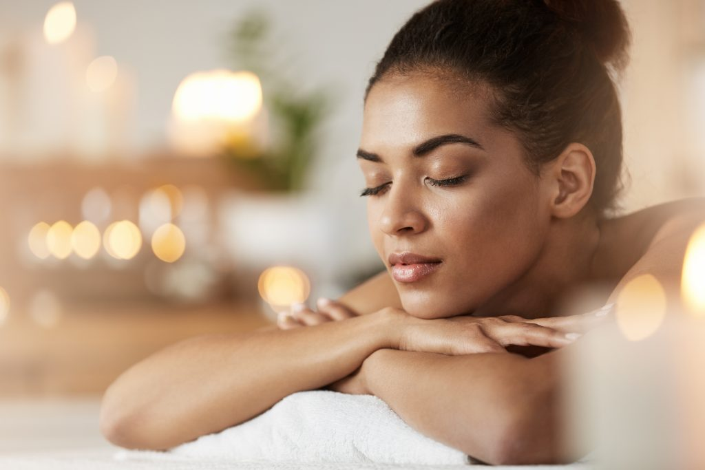 A woman, resting on folded arms, relaxed in a spa